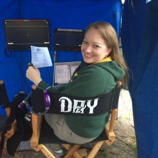Lori at setup with callsheet
